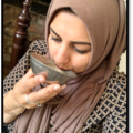 Multaka Volunteer Marriam drinking from her Healing Bowl, a gift from her father