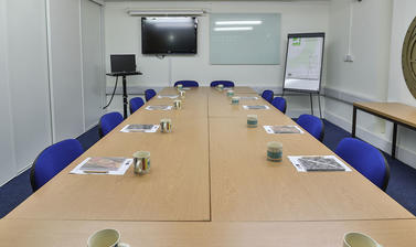 The Seminar Room in a boardroom layout.