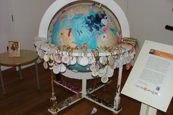 Ivory, shell & silk: picture of globe