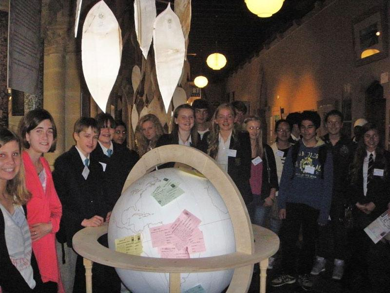 Winners of Activity photo showing Dux Awards Scheme students with the globe